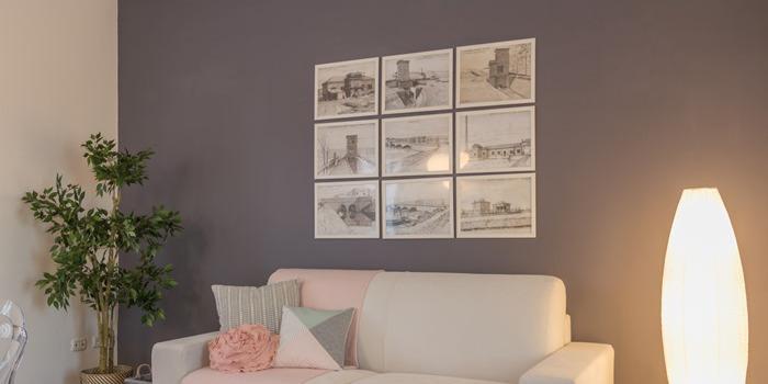 come appendere i quadri sopra il divano? – anna leone architetto